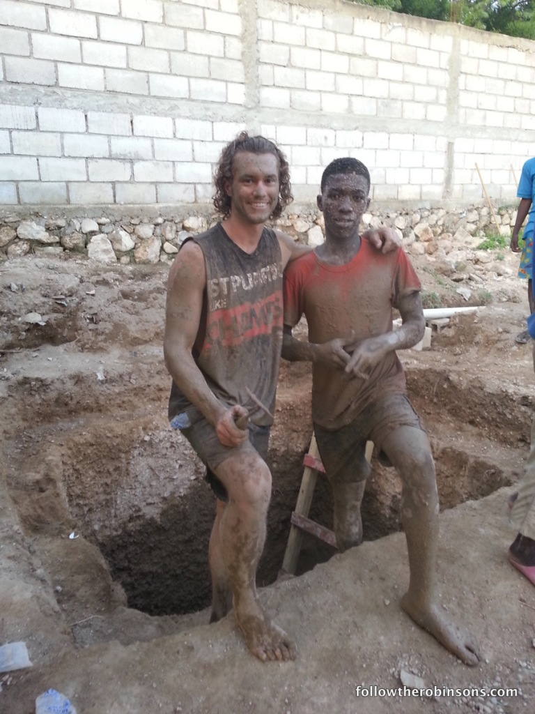 Ryan and a local guy working on a latrine